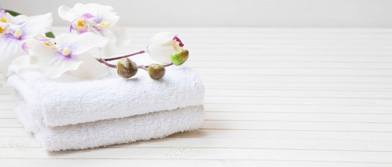 Spa still life with orchid flower and towels