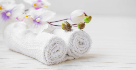 Spa still life with orchid flower and towels, selective focus