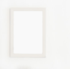 Light  wooden frame for picture hanging on white wall. Blank picture. Template for design