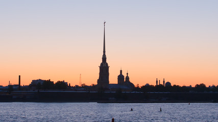 Silhouette of Peter and Paul Fortress in the sunset sky - St. Petersburg, Russia