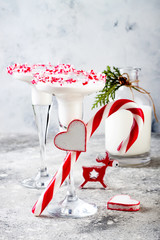 White chocolate peppermint martini with candy cane rim. Christmas holiday party drink idea