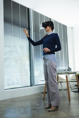 Female executive using virtual headset