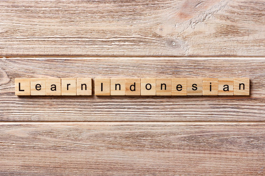 learn indonesian word written on wood block. learn indonesian text on table, concept