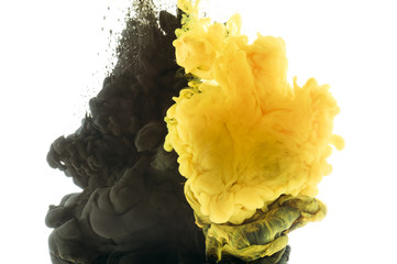 Wall Mural - mixing of black and yellow paint, isolated on white