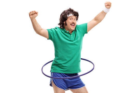 Retro sportsman exercising with a hula hoop