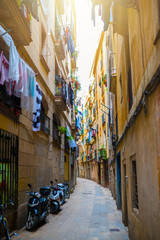 narrow alley in old town Ciutat Vella of Barcelona, Spain
