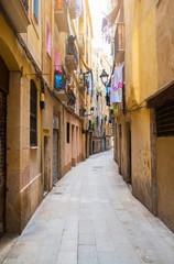 narrow alley in old town Ciutat Vella of Barcelona, Spain
