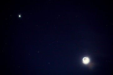 Full blue moon with star at dark night sky background