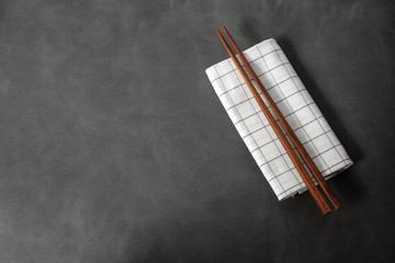 Collection of wooden chopsticks on gray background