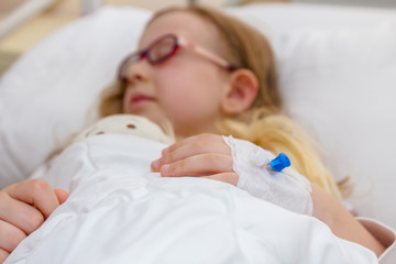 Disposable infusion on patient hand, preschooler child