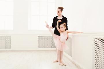 Little girl learn ballet with teacher copy space