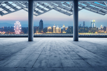 cityscape of modern city at dawn from empty floor