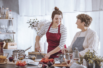 Women in kitchen aprons