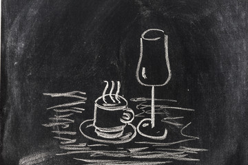 Chalice and coffee cup on blackboard
