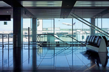 Airport departure lounge seating and escalators