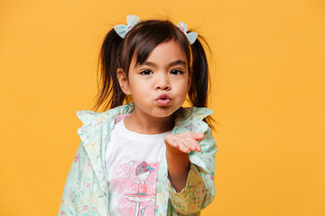Little girl child blowing kisses.