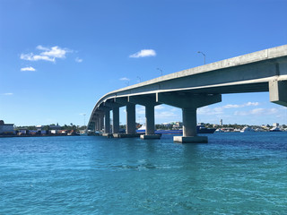 On the water in Nassau, Bahamas in the Caribbean with bridge showing port
