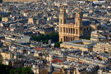 Aerial view on Saint-Sulpice Church and Paris rooftops at sunset (mansard and dormer roofs). 6th Arrondissment, Paris, France