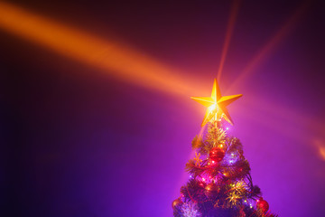 Christmas tree with festive lights, purple background