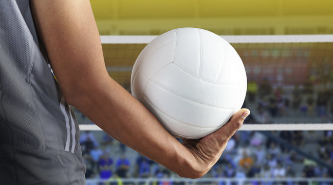 Volleyball player with ball on volleyball court