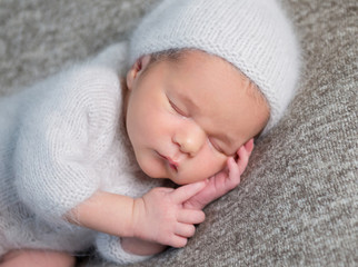 Portrait of newborn baby boy sleeping
