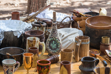 """Viking dishes are on the table at the reconstruction of the life of the Vikings - """"Viking Village"""" in the forest near Ben Shemen in Israel"""
