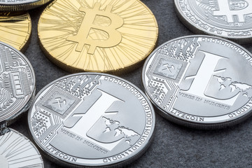 Bitcoin and Litecoin go to the exchange ICO Initial Coin Offering. Cryptocurrencies at dark background