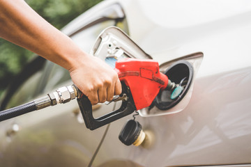 Car refueling on petrol station. Fuel pump with gasoline. This photo can be used for fuel industry or transportation concept.