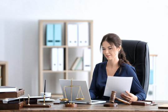Young female notary working in office