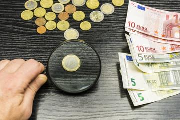 One euro coin through a magnifying glass.