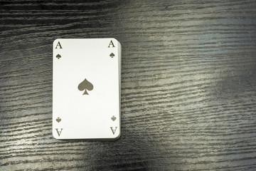 A deck of cards with ace of spades on top.