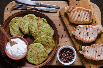 Pork chops with peppers and zucchini pancakes