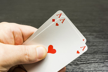 Two aces in the hand held.