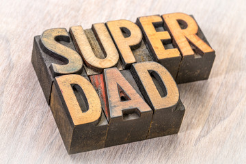 super dad word abstract in wood type