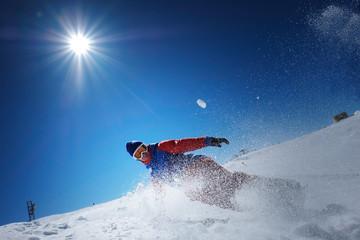 male athlete snowboarder falls on snow