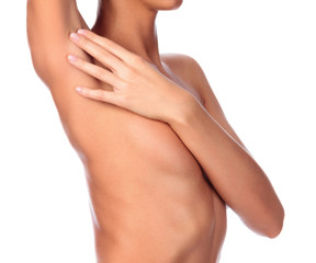 Beautiful female body, isolated on white background. Slim girl touches her shaved armpit. Unwanted hair removal concept