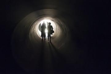 people inside a dark tunnel