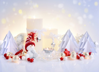 Christmas composition with candles, snowman and paper spruces. Christmas or New Year greeting card.