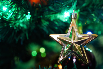 Close up isolated star on christams tree with blured background