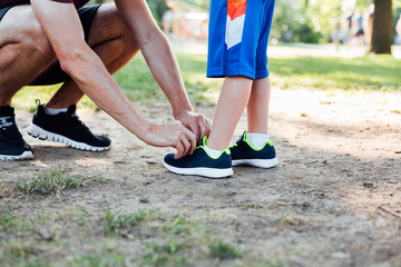 Father preparing son for running