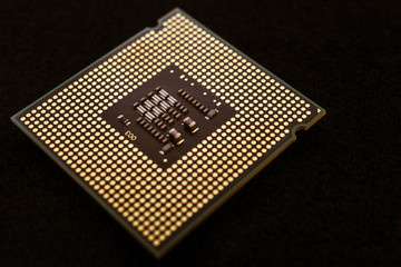 Closeup of an electronic circuit board with a processor.