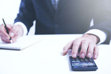Man hand calculator and notepad