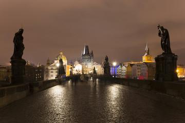 Night snowy Prague Old Town from Charles Bridge, Czech republic