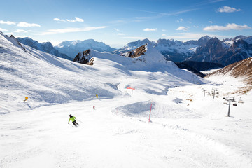 Beautiful ski slope connects Ciampac and Buffaure ski resorts, Val di Fassa valley, Dolomites, Italy