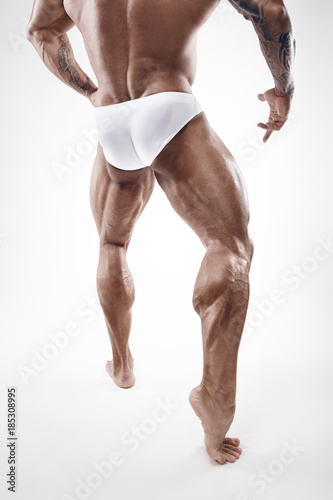Strong Athletic Man Fitness Model Torso showing naked muscular legs ...