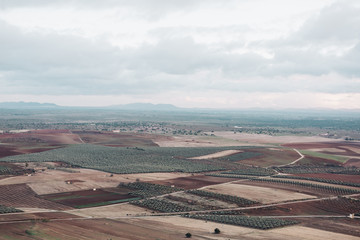 High view of a mosaic landscape on a cloudy day. Spain fields scenery
