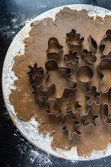 gingerbread dough with cookie cutters top view