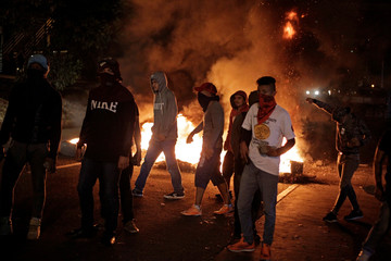 Opposition supporters protest with a burning barricade after Honduras' President Juan Orlando Hernandez declared himself re-elected, in Tegucigalpa, Honduras