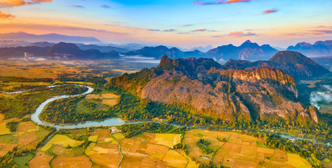 Canvas Prints Honey Aerial view of the fields, river and mountain. Beautiful landscape panorama. Laos.