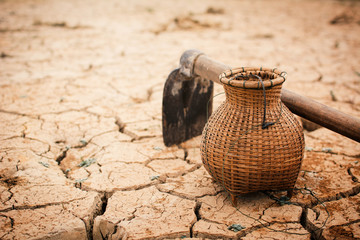spade and wicker on crack dry ground, concept drought